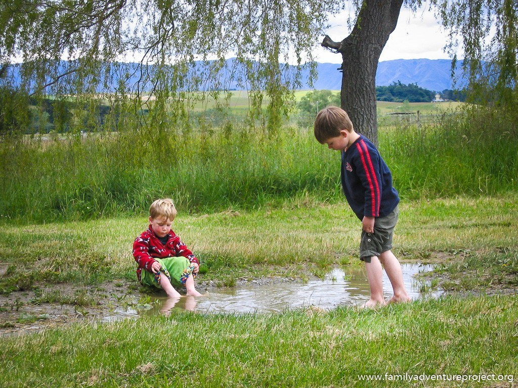 Kids playing in a puddle - the simple joys
