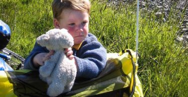 Boy with toy lamb