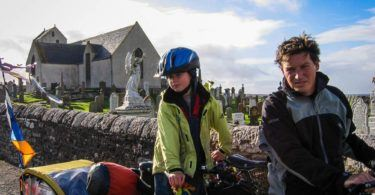 Father and son cycling Caithness Coast Scotland