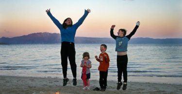 Family celebrating on beach