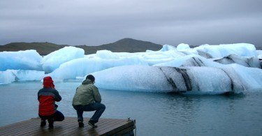 People watching icebergs at Jokulsarlon glacial lagoon