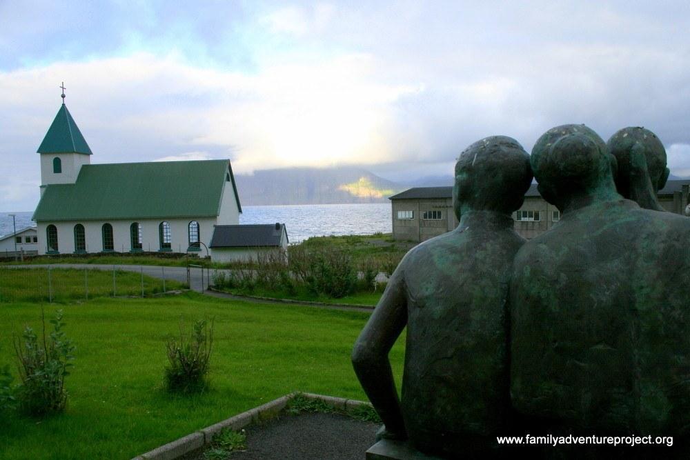 Statue and church, Gjogv, Esturoy, Faroes
