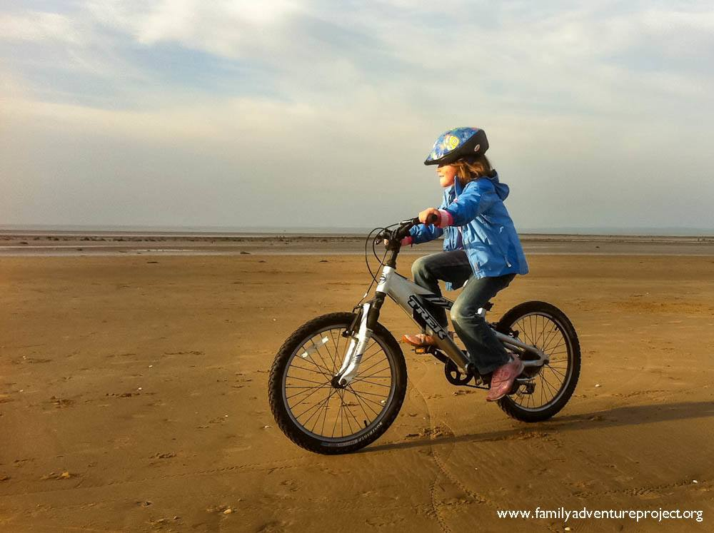 Cycling on beach at Morecambe