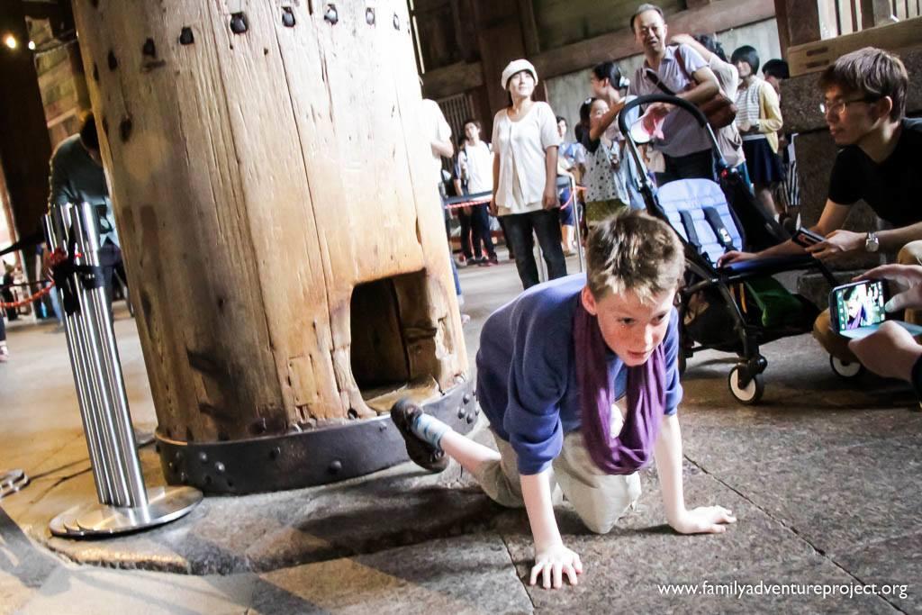 Crawling through the pillar in the Todai-ji Temple Nara