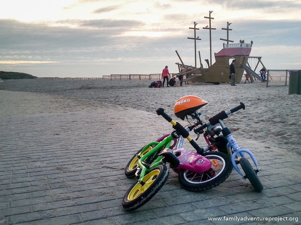 Kids bikes and playground down at the beach on Belgian Coast at De Haan