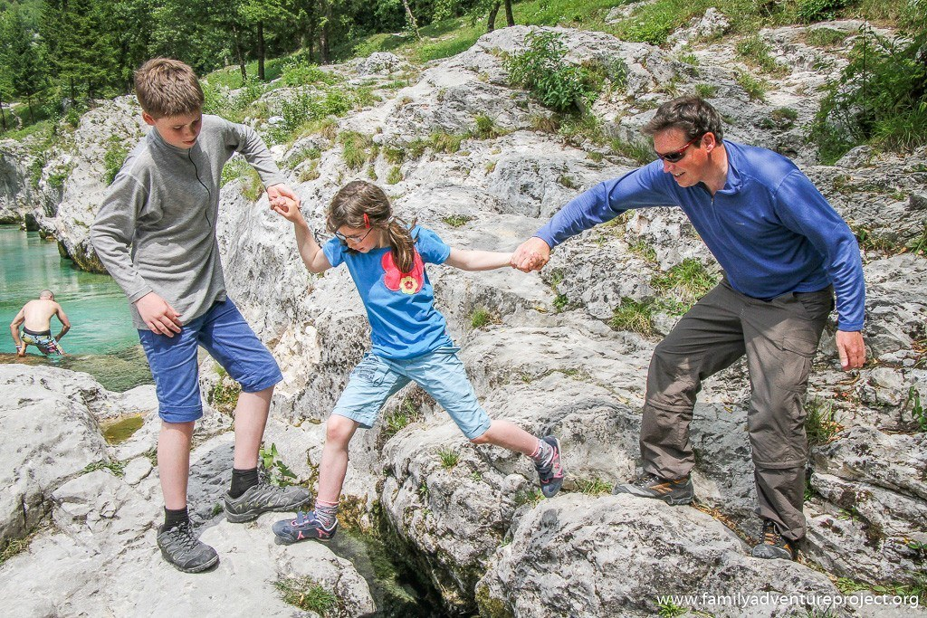 Family working together as a team in Slovenia n River Soca