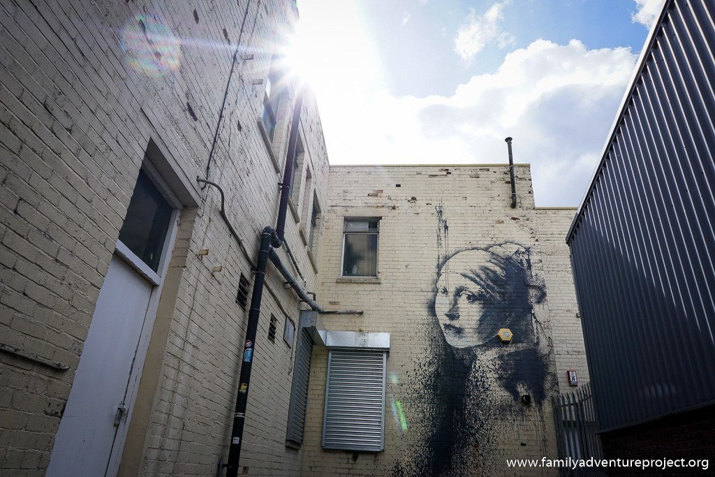 Banksy - Girl with the Pierced Ear Drum - Street Art in Bristol