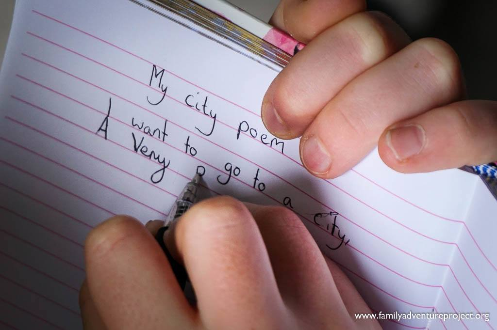Child writing a city poem