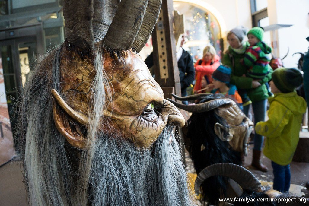 Family checking out the Krampus masks in Salzburg