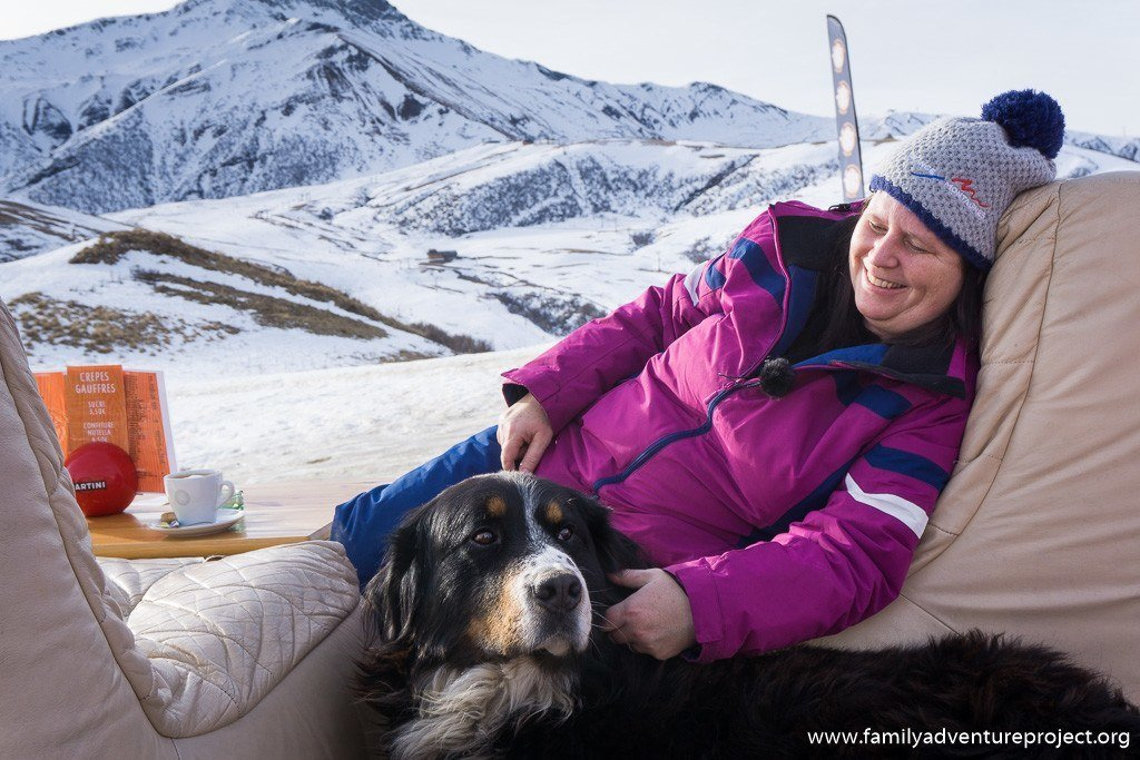 Relaxing with a dog at La Vache Orange, Valmorel