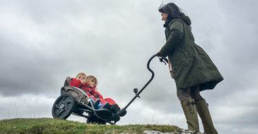 Family out walking with the Yippie Yo Crossbuggy