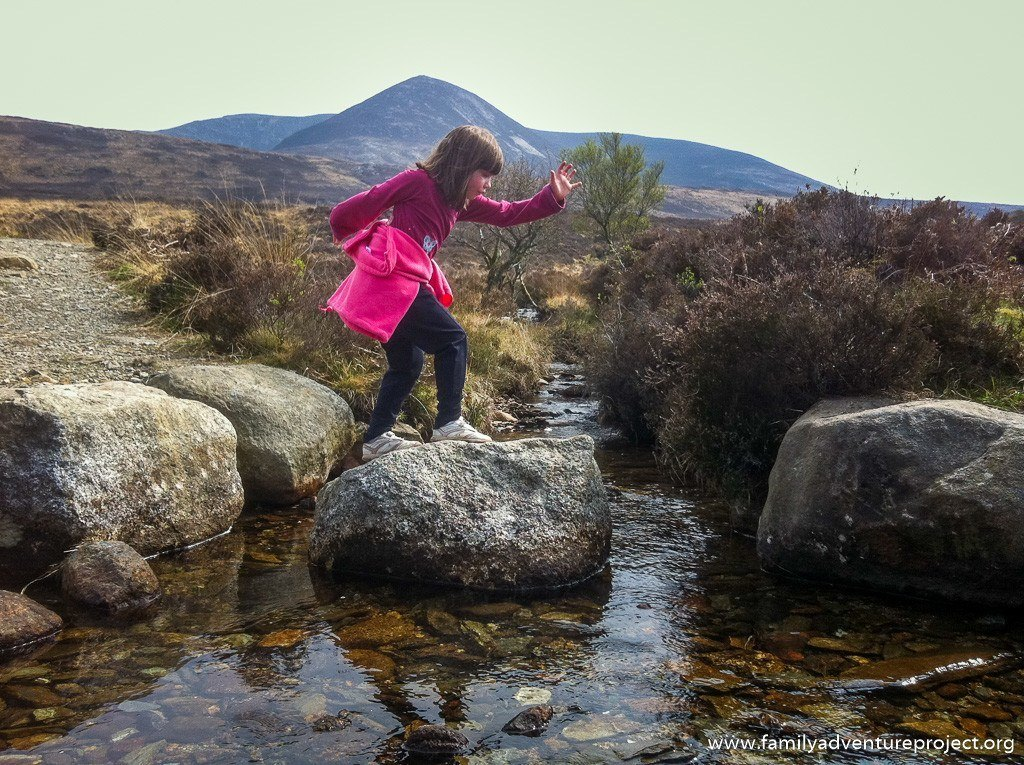 Child Crossing Stepping Stones on Isle of Arran