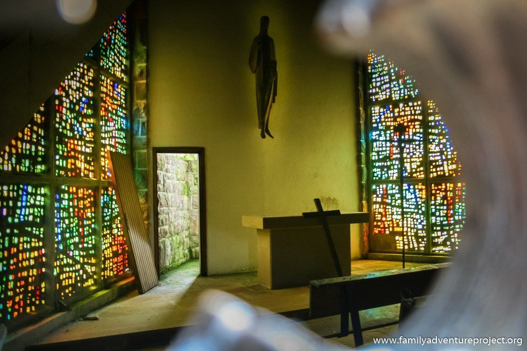 Looking inside the chapel at the Col de Ibaneta, Camino de Santiago