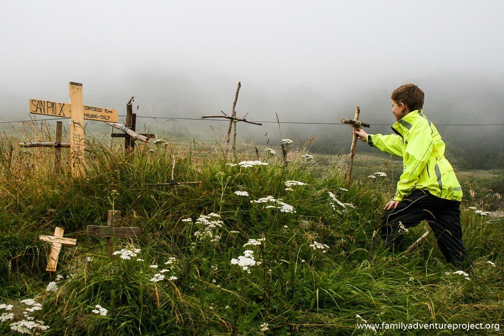 Planting Crosses outside the chapel at the Col de Ibaneta, Camino de Santiago