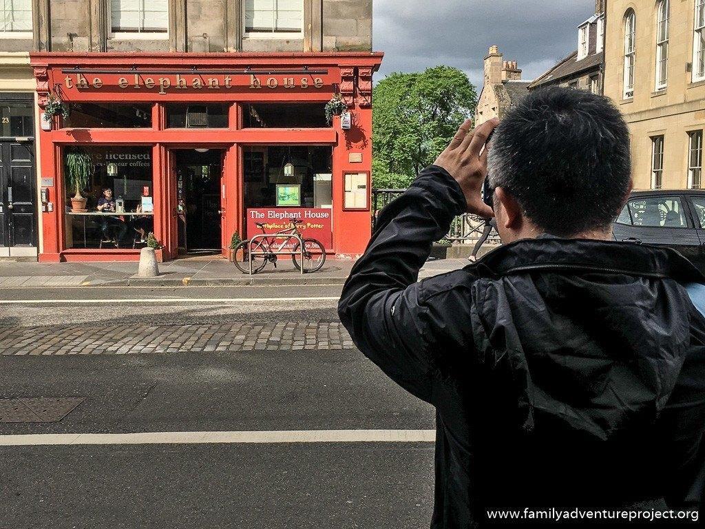 Tourist shooting the Elephant House in Edinburgh