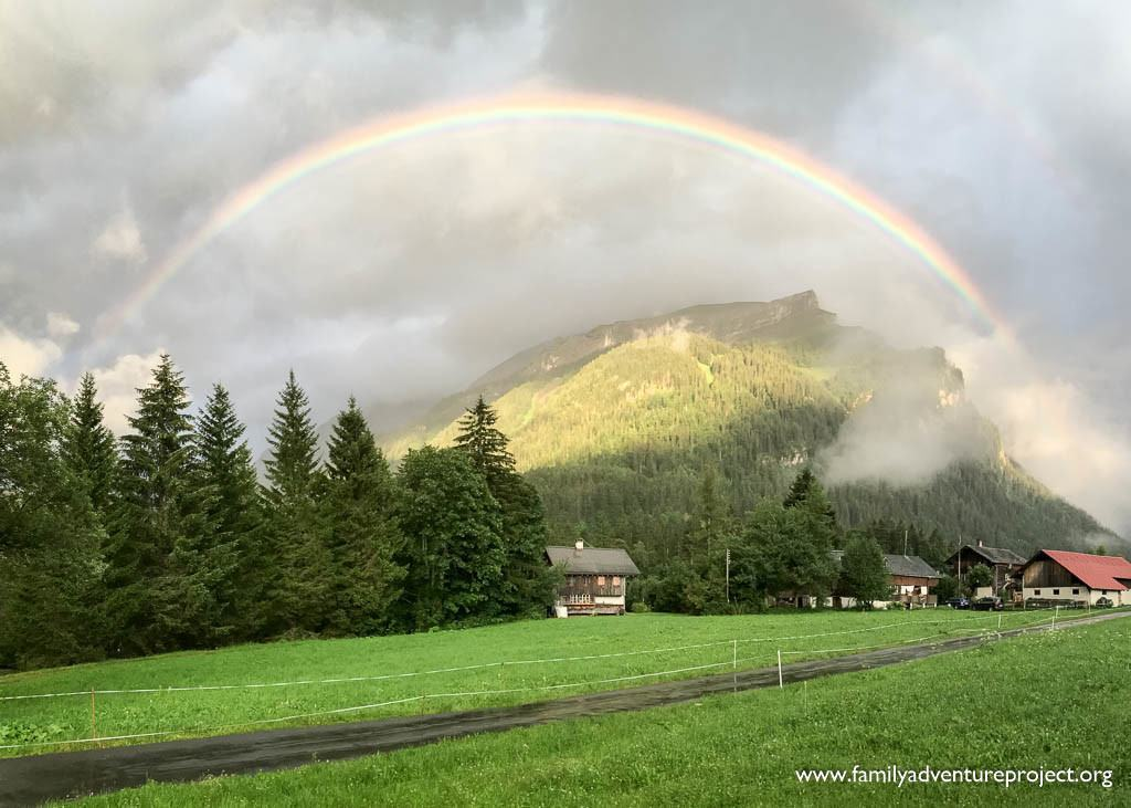 Traditional chalets under a rainbow in Les Diablerets, Switzerland