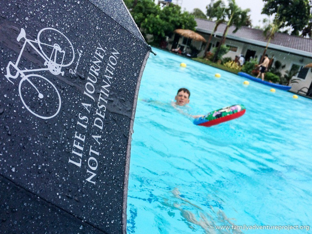 Swimming in the rain at Natures Garden Park Resort, Mactan Island