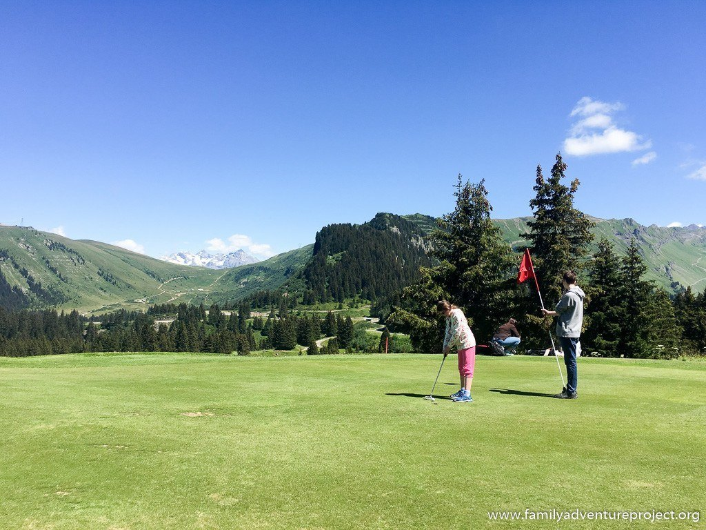 Kids playing golf at Flaine golf course, high mountain golf