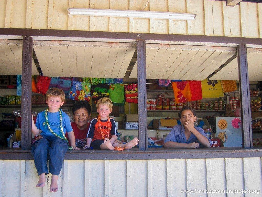 Boys sitting at the shop in Satuiatua, Savai'i, Samoa