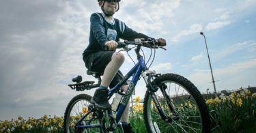 Boy cycling solo amongst daffodils