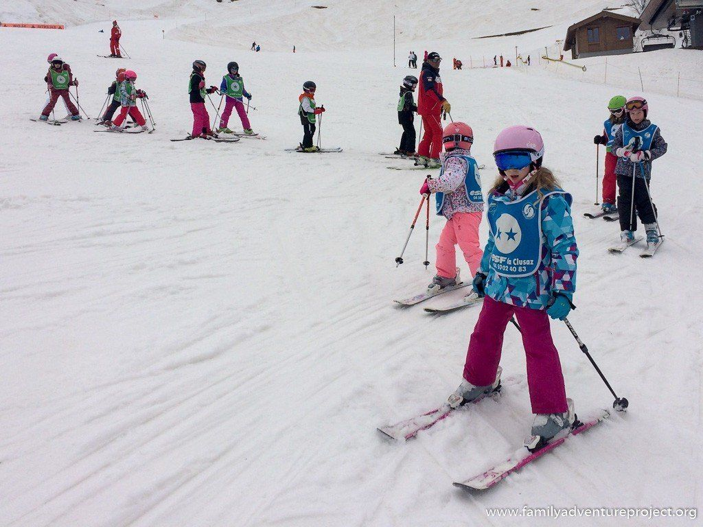 Children skiing in Le Clusaz, at the top of Bossonet lift, Haute Savoie, France