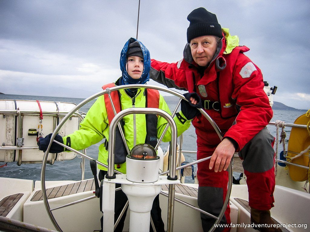 Boy learning to sail with instructor