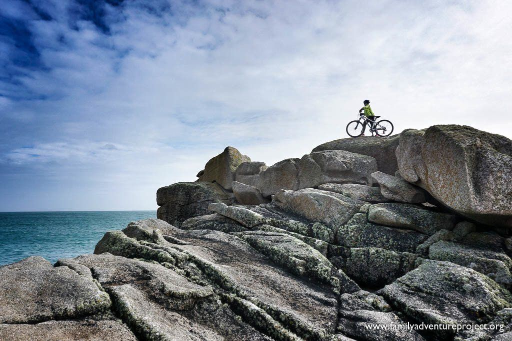 Cycling on Scilly. On the rocks at Old Town Bay, St Mary's