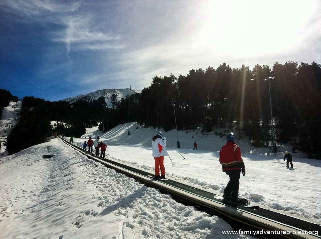 Skiers and snowboarders ascend a conveyor lift in Spanish Pyrenees, Catalonia