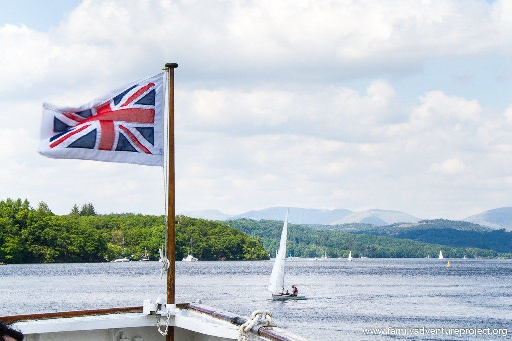 Union jack flutters in the breeze on the front of The Swan, Windermere Lake Cruises